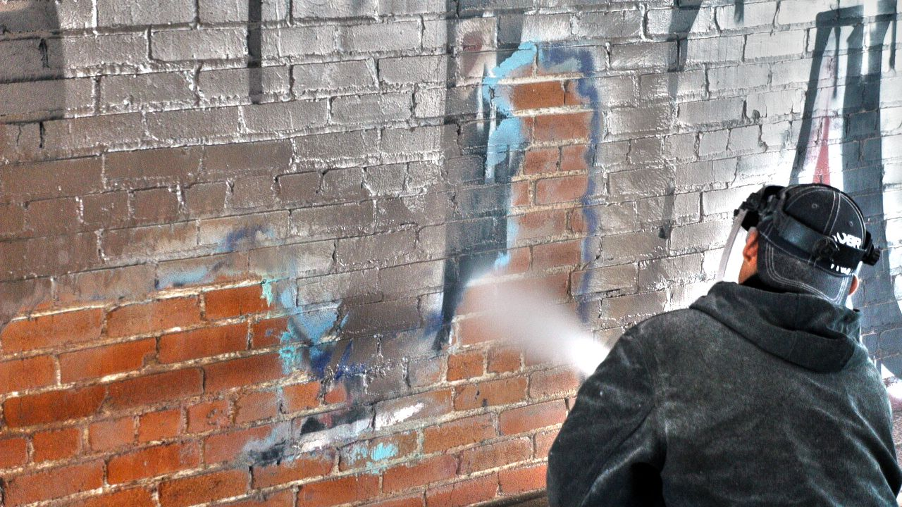 Removing graffiti, old paint from walls